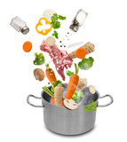 Stainless steel pot with flying ingredients. - 192957102