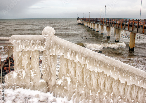 ice covered staircase on the beach