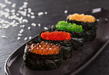 Japanese Sushi over black background. - 192957301