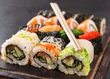 Japanese Sushi over black background. - 192957317