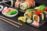Japanese Sushi over black background. - 192957333