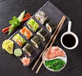 Japanese Sushi over black background. - 192957359