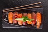 Japanese Sushi over black background. - 192957374