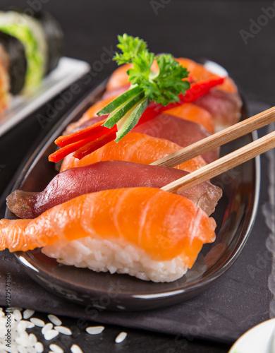 Japanese Sushi over black background.