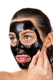Portrait of young healthy woman with black peel face mask. - 192957505