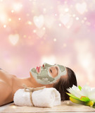 Young healthy woman with face clay mask. - 192957580