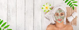 Young healthy woman with face clay mask. - 192957593