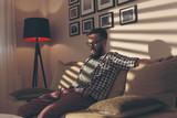Man sitting on a sofa - 192965559