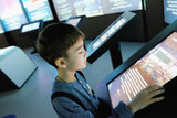 child examines the touchscreen in the interactive Museum - 192967391