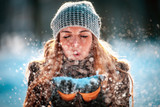 Winter woman blowing snow outdoor at sunny day, flying snowflakes - 192967714