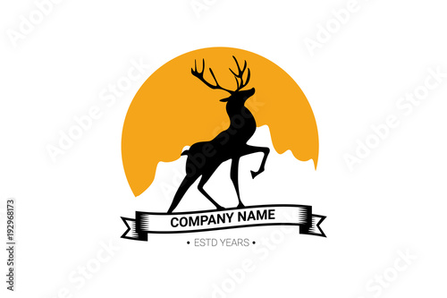 Fotobehang Hipster Hert proud deer on the background of sun and mountains. company logo, logo. ribbon with inscription.