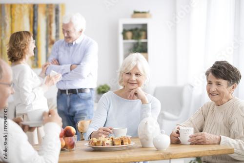 Smiling elderly women drinking tea