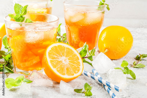 cold-summer-drink-iced-tea-with-lemon-and-mint-on-grey-stone-background-copy-space