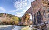 Wonderful ancient bridge over a creek - 192976724