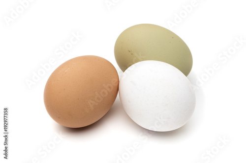 brown, white and green eggs isolated