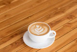 Hot Coffee latte art cappuccino White cup on Wooden table - 192980371