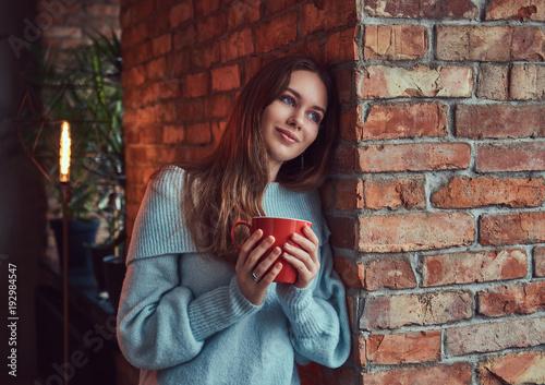 Fotobehang Kapsalon A sensual brunette in a gray sweater