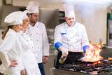 Chef in restaurant kitchen - 192986508