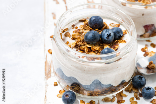 healthy creamy dessert with fresh berries in jar, closeup