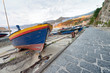 Colorful wooden boat at sunset. Fishermen village