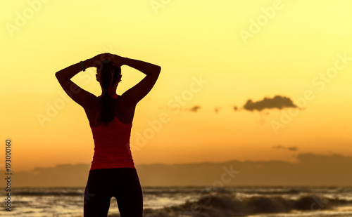 Keuken foto achterwand Zwavel geel relaxed young woman standing in sports gear on seacoast