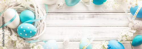 Easter Decoration with Eggs and Flowers on White Wooden Background - 193000909