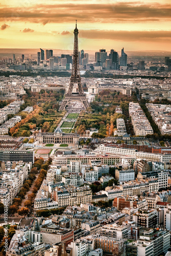 Fototapeta Aerial Paris view in late autumn at sunset. Eiffel Tower in the distance and financial district.