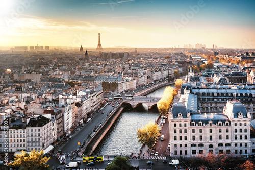 Staande foto Parijs Paris, France - Seine river cityscape in autumn colors. Eiffel Tower and La Defense in the background. Foggy sky.