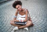 Urban girl using a pc