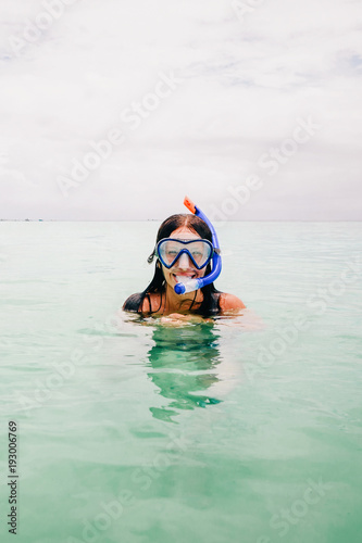Fotobehang Zanzibar Happy woman wearing mask for snorkeling in the turquoise ocean