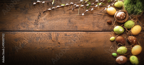 Easter Eggs with Branches on Wood Background - 193007132