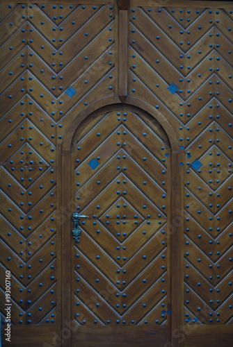 Wooden & metal door. Ancient doors in Prague, Czech. Texture, architecture, background, wallpaper.