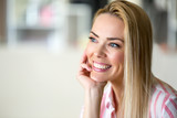 Portrait of cheerful young beautiful blonde woman