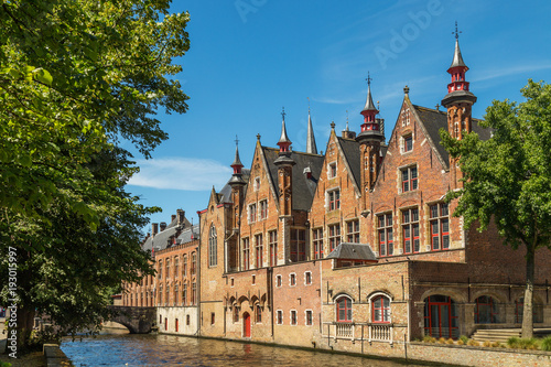 Typical medieval Flemish architecture of Bruges, Belgium. Red brick houses standing on canals
