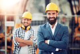 Construction specialist and worker outdoors. - 193020351