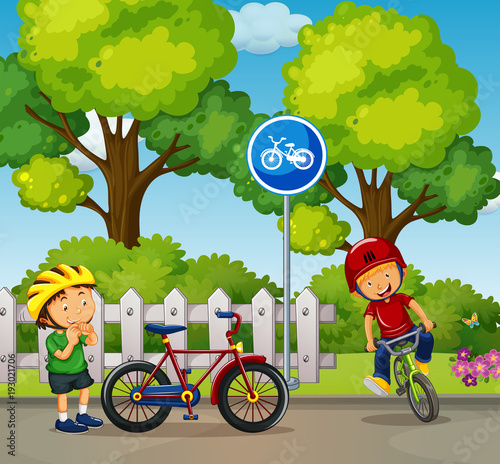Deurstickers Kids Two boys riding bike in the park