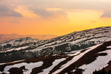 Fantastic spring landscape with snow mountain glowing by evening sunlight. Carpathian mountains. Travel vacations concept - 193022913
