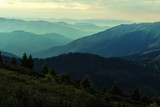 Picturesque summer landscape with colorful sunrise on Carpathian mountains. Mountain ranges in morning light. Travel background concept - 193023551