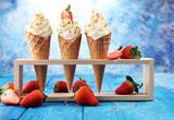 Vanilla frozen yogurt or soft ice cream in waffle cone. - 193023946