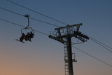 Cable car on sky resort against evening sky, silhouette - 193035152