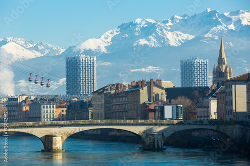Foto Murales Aerial view of Grenoble cable car with French Alps and bridge