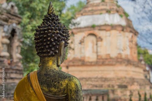 Staande foto Boeddha Thai Buddha Statue Facing Temple in Background