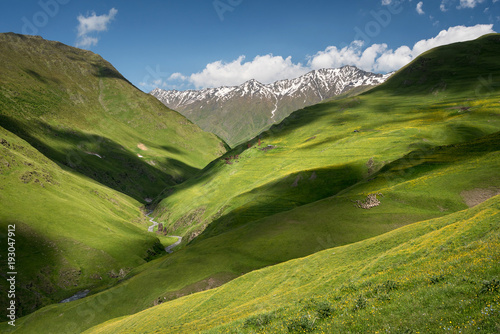 Foto op Plexiglas Pistache Landscape of a mountain valley with view at mountain river and mountain range.