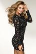 Quadro Sensual beautiful blonde woman posing in black dress. Girl with long curly hair.