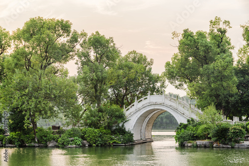 Evening view of white twin marble bridge on lake, Guilin