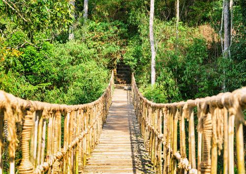 Fotobehang Bamboe Scenic footbridge made from rope and bamboo