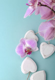 pink orchid and wooden white heart on blue background - 193098903