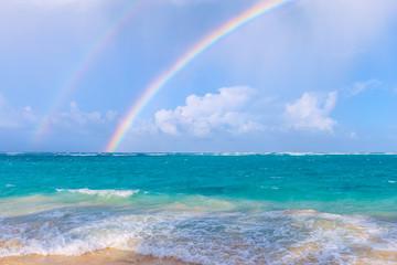 Double rainbow over the sea.