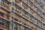 scaffolding around the house - historical building facade renovation - 193099770