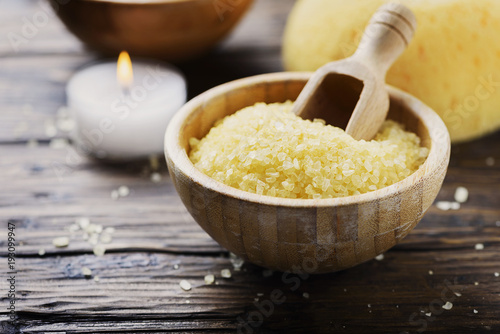 Foto op Canvas Spa Concept of spa therapy and wellness with yellow salt and candles